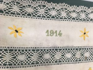 Close up of one panel of the flour sack, with the year 1915 and two flowers