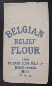 "a plain flour sack circa 1914. It reads: ""BELGIAN / RELIEF / FLOUR / FROM/ PILLSBURY FLOUR MILLS CO. / MINNEAPOLIS / MINN. / U.S.A."